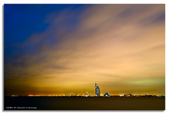 Clouds...At Last! (DanielKHC) Tags: digital blending danielkhc explore frontpage uae dubai palm island jumeirah burj al arab khalifa dusk clouds sunset nikon d300 sigma18200mm danielcheong cityscape skyline long exposure 22 fp interestingness gettyimagesmeandafrica1 hdr high dynamic range