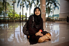 Snapshot: Smiling in Putrajaya (Taqi) Tags: woman girl smile canon muslim islam headscarf hijab portraiture malaysia wife putrajaya vignette malay songket flowerofislam