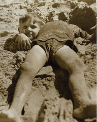 Billy and Graham Green from the Salvation Army Camp practise a little deceit, Collaroy Beach, ca. 1940 / photographer unknown (State Library of New South Wales collection) Tags: beach strand crazy sand salvationarmy buried joke photojournalism super kinder faves trick aussie deceit decapitated cossie grahamgreen collaroybeach williamgreen billygreen bpaiixao horsemaning