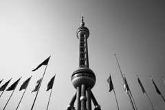 Power (zeniale) Tags: china city travel sky urban bw white black building tower monochrome architecture cityscape power shanghai wideangle flags structure pearl   oriental pudong telecommunication lujiazui