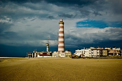 Barra, Aveiro (Coussier) Tags: blue sky sun lighthouse white tree green folhas sol portugal azul clouds happy stripes sunny cu nuvens riscas rocket feliz farol erection sexual arvore alegre folha nuvem tension leafes barra outono aveiro autom costanova
