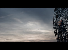wheel of wonder. (Vitaliy P.) Tags: park new york city nyc light sunset red orange white black film wheel brooklyn movie wonder island golden amusement nikon bars explore hour crop gothamist coney cinematic explored d80 18135mm fortheloveofbrooklyn vitaliyp ftlob ftlob0510