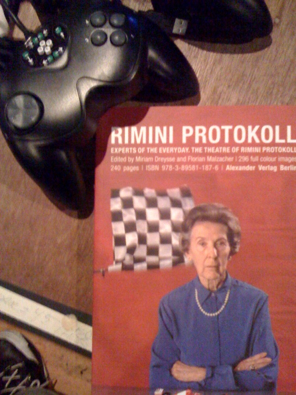 gamecontroller and book