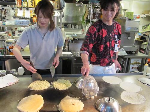 Okonomiyaki cooks in Hiroshima