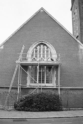 Mason Repairing Window