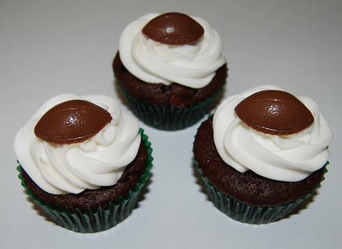 football cupcakes with green cupcake liners