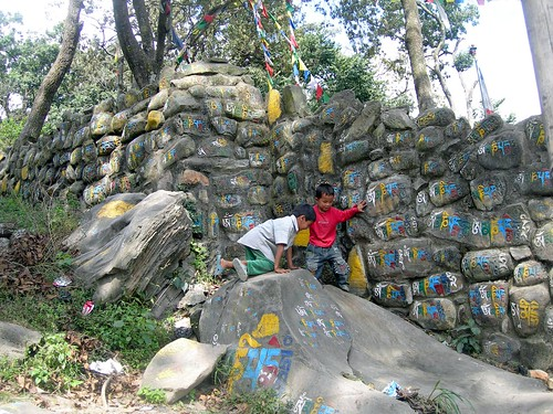 Tibetan Kids playing among 108 carved Mani Stones, Kathmandu, Nepal by Wonderlane