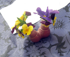 pansies in a purple double vase