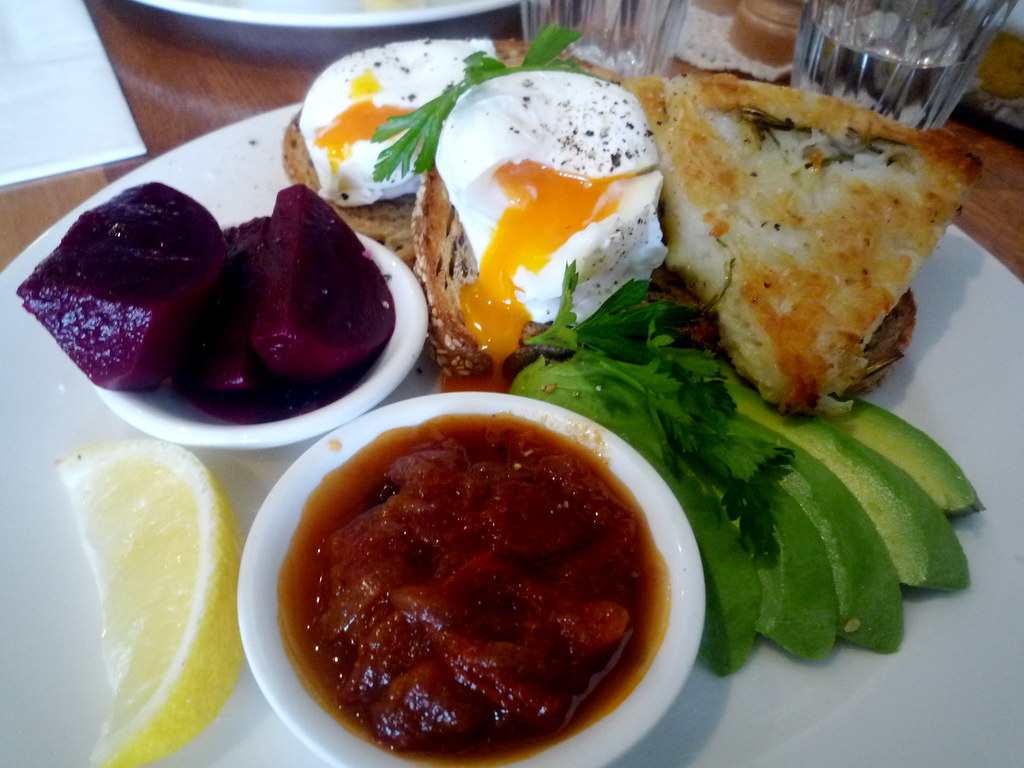 Poached eggs with potato and rosemary rosti, avocado, relish and pickled beetroot