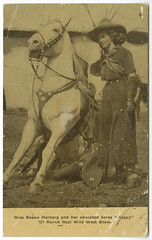 "Miss Bessie Herberg and her educated horse ""Happy"" (SMU Central University Libraries) Tags: horses sitting cowgirls uswest gloved throwbackthursday bessieherberg realwildwestshow bessieherbergcarterblackwell18961943 millerbrothers101ranch 101ranchwildwestshow"