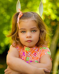 M. (Rebecca812) Tags: light portrait sunlight tree girl beautiful kids children outside kid eyes pretty child eyelashes serious sweet sister balcony daughter naturallight m hazel ribbon pigtails canon5dmarkii familygetty2010 rebecca812