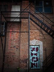 RIDE (RyanMussbacher) Tags: door blue canada brick graffiti edmonton ride panasonic staircase fireescape northamerica lumixgf1 panasonicgf1