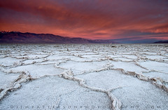 Badwater Burning - Death Valley National Park, California (Jim Patterson Photography) Tags: california morning pink sky mountains color nature clouds sunrise crust landscape dawn colorful desert natural patterns salt dry rope basin saltflats crusty daybreak formations newyearsday mojavedesert 2010 badwater deathvalleynationalpark nikkor1224mm inyocounty graduatedneutraldensityfilter singhray nikond300 jimpattersonphotography jimpattersonphotographycom seatosummitworkshops seatosummitworkshopscom