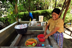GTM-Chimaltenango-1010-107-v1 (anthonyasael) Tags: people woman house home water smile smiling america healthy guatemala mother washing indigenous centralamerica dwelling washinghands chimaltenango anthonyasael