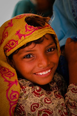 Sindhi girl (Lil [Kristen Elsby]) Tags: unicef pakistan camp girl smile asia child veil topv1111 emergency sindh floods naturaldisaster southasia reliefcamp idp humanitarianaid dupatta jamshoro monsoonfloods