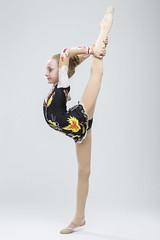 Sport concepts and Ideas. Young Caucasian Female Rhythmic Gymnast Athlete In Professional Competitive Suit Doing Vertical Split  Exercise While Posing in Studio Against White. (DmitryMorgan) Tags: 1 711years active aerobics art artistic athlete beautiful bend body bodysuit caucasian champion child childhood colorful dynamic elegant exercise female fitness flexible gimnastika girl grace gymnast gymnastics healthy individual lady lifestyle one preschooler professional rhythmic rhythmicgymnastic rhytmic split splits sport sportswear sportswoman sporty stretching studio training wellbeing wellness