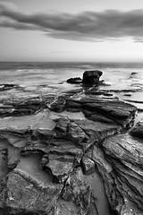 Fractures (DavidFrutos) Tags: longexposure sea bw costa seascape david water rock stone clouds landscape monocromo coast mar rocks waves stones sony wave playa paisaje bn alicante filter nd alfa alpha filters olas roca rocas ola torrevieja alacant filtro sigma1020mm cokin largaexposicin filtros fractures nd8 p121s sonydslr densidadneutra davidfrutos 700 cabocervera niksilverefexpro