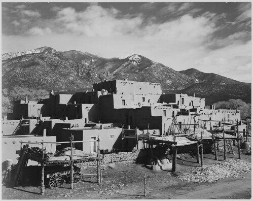 "Full view of city, mountains in background, ""Taos Pueblo National Historic Landmark, New Mexico, 1941."""