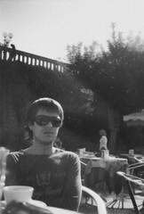 coffee break (mol4anov) Tags: world road city trip travel autumn friends boy bw italy guy film sunglasses florence blackwhite cafe lomo europe 2009 smena8m plenka andrii