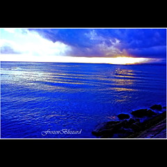 A Blue Blue Sea.... [EXPLORED] (FrozenBlizzard (I need to get a PRO Account soon)) Tags: ocean blue sea sky cloud sun seascape nature stone clouds digital canon photography photo interestingness interesting ray skies photos philippines explore rays sunrays pinoy pilipinas pinas bluesea explored canoneos450d mygearandmepremium mygearandmebronze mygearandmesilver
