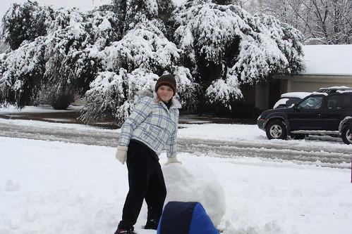 T is building a snowman