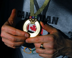 Olympic Gold Medal - Canada Wins (Tomitheos) Tags: portrait classic hockey gold flickr treasure unitedstates image avatar pantheon champion picture photojournalism hellas optical pic daily jewellery photograph bling athletes elegant capture now acropolis today goldplated weight vancouverbc olympicvillage gettyimages 2010 ancientgreece pounds puregold competitions rossland stockphotography £ olympians idas winterolympics vancouver2010 24kgold olympicchampion redmapleleaf curetes ctvnews goldmedalists φωτογραφία silvergilt goldsilverbronze 02202010 bytomitheos qualityofkarategoldstamp 99puregold 99percentageofpuregoldcontent 24kor999 1st2nd3rdplace kallipateira canadianflagsymbol ὀλυμπιακοὶἀγῶνεσ dactylsofida cretanidaheracles paeonaeus epimedes iasius τὰολύμπια pherenike olympicmulticolorrings mountmtroberts 1987meterselevation6520feet lorentzmedal teamcanadaworldrecord
