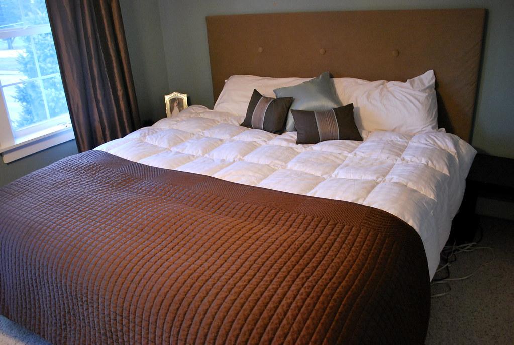 B. Comforter Under, Quilt Folded In Half On Top