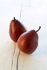Two Red Pears (noam.armonn) Tags: light red two stilllife food white fruit painting lunch cuisine daylight wooden healthy stem bright surface fresh eat snack pear classical produce organic diet agriculture culinary bartlett ripe nutrition nutritious