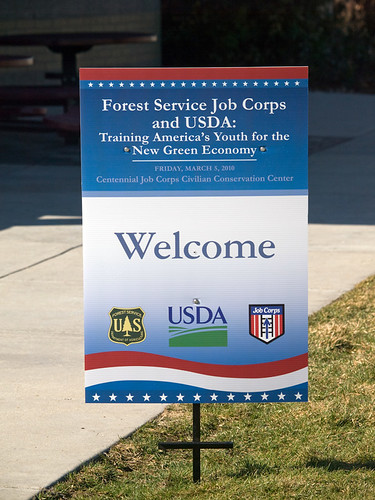 Sign features the design and theme of the event--Forest Service Job Corps and USDA: Training America's Youth for the New Green Economy