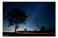 Should I stay or Should I go ([ Kane ]) Tags: road longexposure light sky west tree car night clouds dark stars queensland kane celestial startrail gledhill 50d southstar kanegledhill celestialpoint celestialpoles wwwhumanhabitscomau kanegledhillphotography