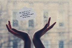 My head is in a cloud of rain and the world it seems so far away. {explored!} (dimplyemily) Tags: window rain clouds paper droplets hands colbiecaillat