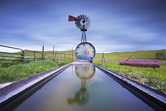Windmill Water Trough:  Zamora, California (Ivan Sohrakoff) Tags: california sunset usa storm green water windmill grass northerncalifornia clouds fence woodland landscape spring tank sundown i5 wind farm country farming grain hills pasture fields grasses roadside agriculture watertank rollinghills zamora countryroad trough reallyrightstuff rrs dunnigan ndfilter landscapephotography watertrough esparto neutraldensity dunniganhills californiaphotography leefilters northerncalifornialandscape northerncaliforniaphotography