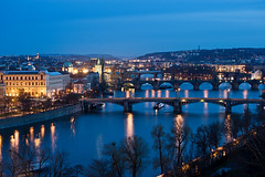 Bridges Over The Vltava (Philipp Klinger Photography) Tags: road street bridge blue light shadow sky orange house motion blur reflection tree tower cars church water car yellow architecture night strand river boat movement nikon europa europe ship republic riverside czech prague hill border bank prag charles praha tschechien east most hour eastern buidling karluv republika strana letna karlv mal ceska sady karlsbrcke kleinseite tschechei letenske letensk nikon70300mmvr d700 vanagram hhel