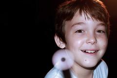 tamarindo (juansebastianf) Tags: boy portrait blackandwhite white black darkroom dark lens happy focus innocent lensflare flare innocence