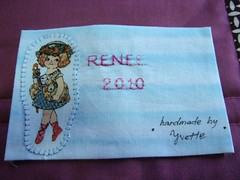 Machine appliqued doll label