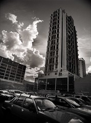 temple of the clouds (mugley) Tags: city sky urban blackandwhite bw tower cars 120 film architecture modern clouds rollei skyscraper buildings mediumformat prime parkinglot 645 apartments columns grain perspective australia melbourne wideangle victoria scan vehicles negative epson parked cbd carpark 6x45 vignetting residential r3 cloudporn mamiya645 urbanlandscape redfilter roofrack polariser 25a v700 cloudage keystoning stewartst mamiya645protl m645 rolleir3 franklinlofts 35mmf35sekorn peddlethorp