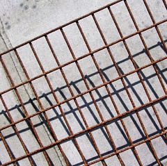 Grid and shadows (tina negus) Tags: abstract grid rust iron harbour shed angles northumberland holyisland