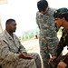 Marine Sgt. Nathan Brewer tries to reconcile a difference with an Afghan National Army soldier