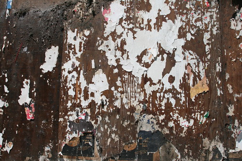 Brown Wall with Ripped Papers
