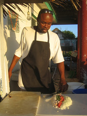 Donovan making Conch Salad (Ellen Bulger) Tags: ocean sea vacation people food sun shells fish beach kitchen coral island person cuisine restaurant town sand village flavor humanity cook tasty delicious eat human hunger ingredients chew marinebiology hungry taste swallow bahamas reef folks groceries idyllic eleuthera fishingvillage mollusk foodstuff nutritious bahamian homosapiens shallows tarpumbay nutrient outislands familyislands
