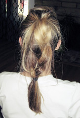 messy pony tail braid
