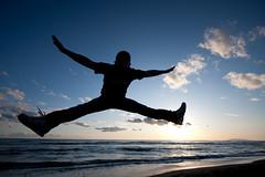 we love jump (Roberto_Ventre) Tags: boy sunset sky people italy man beach silhouette rock marina canon freedom evening fly jump italia tramonto blu cielo single salto libert volare velka singolo 40d marinavelka