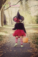 Too Cute to Spook... (Kimberly Chorney) Tags: street sunlight cute leaves walking trickortreating littlewitch redtutu sildwalk stippedsocks pumkinpail