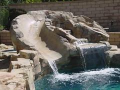 Swimming Pool Rock Waterfall and Slide (HowtoBuildYourOwnPool.com) Tags: pool rock swimming tile design backyard coat ground pebble pools quotes fiberglass custom spas gunite expresspoolquotescom