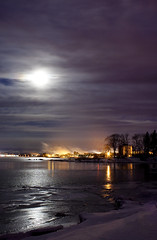 City (Billy Wilson Photography) Tags: city longexposure morning trees winter sky moon ontario canada cold reflection tree wet water night clouds digital canon reflections dark eos rebel lights lowlight atmosphere xs soo northern 2010 saultstemarie northernontario algoma billywilson