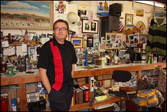 This Is Me -- A Studio Self-Portrait (greenthumb_38) Tags: desktop selfportrait studio desk flash memories stuff stories timer 1740mm clutter workbench mancave canon40d jeffreybass redforthepeopleofberma