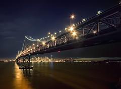 A View From Treasure Island (Lee Sie) Tags: sanfrancisco california city bridge reflection water skyline night lights golden bay gate treasureisland nightshot baybridge bayarea yerbabuenaisland sigma1020mm nikond40