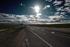 Glaring (Clint Koehler) Tags: road sky sun mountains lines turkey vanishingpoint asia horizon tarus nikond700 142428 tarusmountains