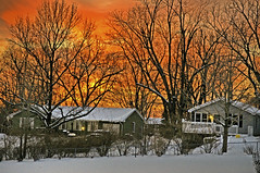 January Sunset (FotoEdge) Tags: sunset fire excelsiorsprings mo missouri hallofwaters sun sundown clouds winter snow glowing reds oranges yellows fotoedge streets icy 2010