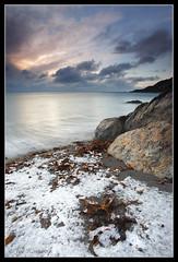 Snow Tide (Joe Rainbow) Tags: ocean longexposure sea sky snow seascape seaweed beach water sunrise landscape rocks cornwall skies wave granit